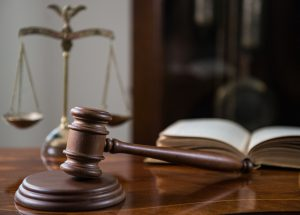 Sixth Circuit Invalidates Contractual Limitations Period for Title VII Claims - photo of gavel and scales of justice